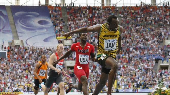 Jamaica's Usain Bolt, right, goes to cross the finish line ahead of United States' Justin Gatlin, second from right, and Germany's Martin Keller in the women's 4x100-meter relay final at the World Athletics Championships in the Luzhniki stadium in Moscow, Russia, Sunday, Aug. 18, 2013. (AP Photo/Matt Dunham)