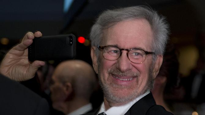 Director Steven Spielberg uses his smart phone during the White House Correspondents' Association Dinner at the Washington Hilton Hotel, Saturday, April 27, 2013, in Washington.  (AP Photo/Carolyn Kaster)