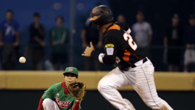 Nuevo Laredo, Mexico's Marcelo Perez, left, catches a line out by Taoyuan County, Taiwan's Meng-Chun Sung (not pictured) as Chun-En Lin runs the bases in the fifth inning of a pool play baseball game at the Little League World Series, Monday, Aug. 20, 2012, in South Williamsport, Pa. Mexico won 4-3. (AP Photo/Matt Slocum)