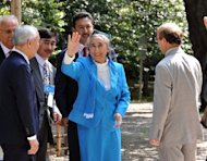 Exiled president of the World Uighur Congress Rebiya Kadeer waves to wellwishers as she leaves the Yasukuni shrine in Tokyo. Kadeer says her people face a fight for their very existence against Chinese repression as a conference in Japan threatens to drive a wedge between Tokyo and Beijing