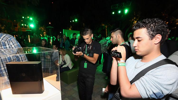 IMAGE DISTRIBUTED FOR MICROSOFT - Members of the press photograph the Xbox One for the first time at Xbox Showcase at E3 2013 at the Vibiana in Los Angeles on Monday, June 10, 2013. (Photo by Casey Rodgers/Invision for Microsoft/AP Images)