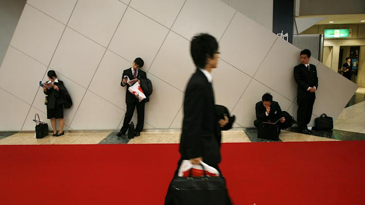 FILE - In this Feb. 9, 2007, file photo, recent graduates line up to see potential employers at a job fair in Tokyo. According to a three-month AP investigation released in January 2013, five years after the start of the Great Recession, millions of middle-class jobs have disappeared from the global economy and have been replaced by technology. (AP Photo/David Guttenfelder, File)