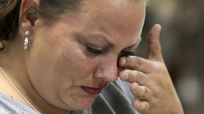 "In this Wednesday, Oct. 10, 2012 photo, apparel worker Misti Keeton wipes tears from her eyes as she talks about the possibility of losing her job to a convict, at American Power Source in Fayette, Ala. Keeton was at work sewing military apparel. Her employer, American Power Source, is laying off about 50 workers at her plant and another one in Columbus, Miss., after losing a contract to make Air Force exercise garb to Unicor. ""I'm terrified,"" Keeton said as she fed camouflage cloth through a machine with one hand and wiped away tears with the other. ""I've got two teenagers at home. I don't know what I'm supposed to say to them if I lose this job. I don't know what I'm supposed to feed them."" (AP Photo/Dave Martin)"