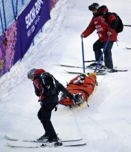 United States' Heidi Kloser is stretchered off the course after crashing in a warm up run before qualifying in the women's moguls at the Rosa Kutor Exreme Park ahead of the 2014 Winter Olympics, Thursday, Feb. 6, 2014, in Krasnaya Polyana, Russia. (AP Photo/Andy Wong)