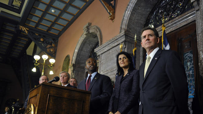 U.S. Rep. Tim Scott, center, speaks to the media during a news conference as South Carolina Gov. Nikki Haley, second from right, and Sen. Jim DeMint, right, look on at the South Carolina Statehouse on Monday, Dec. 17, 2012, in Columbia, S.C. Haley picked Scott to be the state's next U.S. senator Monday, making him the only black Republican in Congress and the South's first black Republican senator since Reconstruction. (AP Photo/Rainier Ehrhardt)