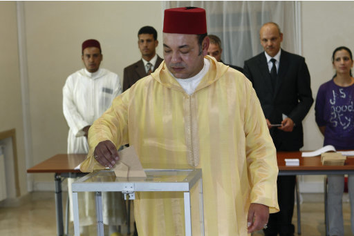 Morocco's King Mohammed VI casts his vote in a polling station in Rabat, Morocco, Friday Jul 1, 2011. The King voted in the referendum on the new constitution. Moroccans vote Friday on whether to adopt a new constitution that the king has championed as an answer to demands for greater freedoms but that protesters say will still leave the monarch firmly in control.(AP Photo/Abdeljalil Bounhar)