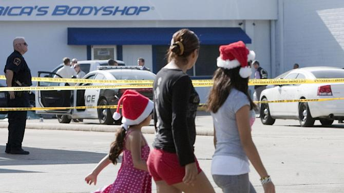 Sarai Rojas, center, walks with her daughters Kimberly Gonzalez, 11, and  Josselyn Rojas, 5, past crime tape as police investigate the crime scene where a Bellaire police officer and a bystander were shot to death after a motorist opened fire following a traffic stop Monday morning Monday, Dec. 24, 2012, in Houston. The confrontation followed a chase that began shortly before 9 a.m. Monday when the suspect sped off in his car rather than pull over as an officer had requested, Houston police spokesman John Cannon said. (AP Photo/Houston Chronicle, Johnny Hanson)