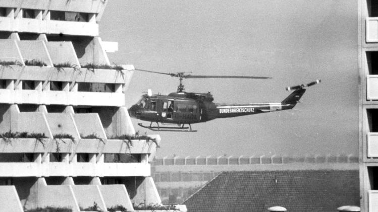 FILE - In this Sept. 5, 1972 file photo, a West German border police helicopter is about to land at the Olympic Village in Munich, after terrorists held 13 Israelis hostage inside the village. The helicopter is reported to be ready to fly the terrorists to Munich airport if the West German goverment agrees to the demands of the terrorists. (AP Photo/File)