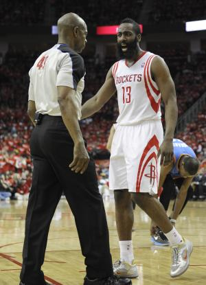 Houston Rockets' James Harden has words with referee Tom Washington in the second quarter of Game 6 in a first-round NBA basketball playoff series against the Oklahoma City Thunder, Friday, May 3, 2013, in Houston. (AP Photo/Pat Sullivan)