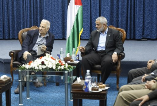 Hamas prime minister in Gaza Haniyeh gestures during a meeting with Nasir, chairman of the Palestinian Central Election Commission in Gaza City