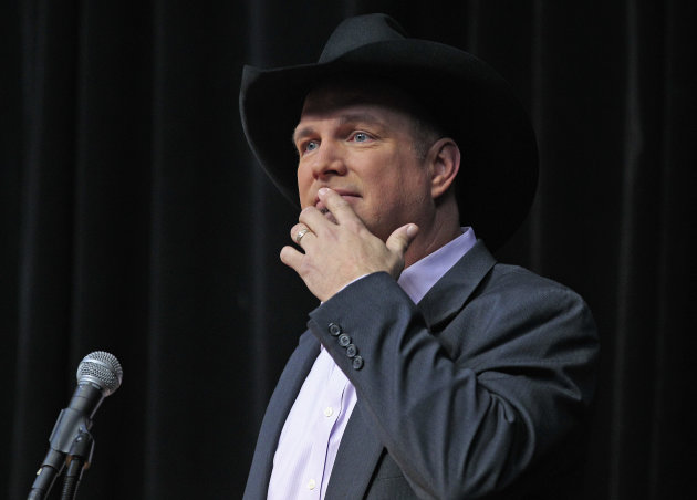 "Garth Brooks pauses to compose himself as he thanks the crowd Tuesday, March 6, 2012, during the announcement that he will be inducted into the Country Music Hall of Fame in Nashville, Tenn. Brooks, Connie Smith, and Hargus ""Pig"" Robbins will become the newest members. (AP Photo/Mark Humphrey)"