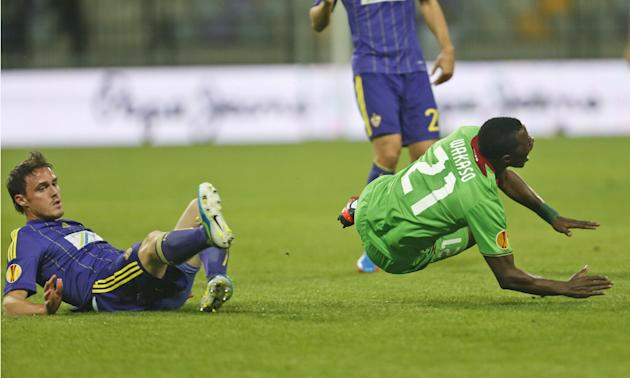 Rubin Kazan's Wakaso Mubarak, right, is tackled by Maribor's Ales Mejac during their group D Europa League soccer match, in Maribor, Slovenia, Thursday, Sept. 19, 2013