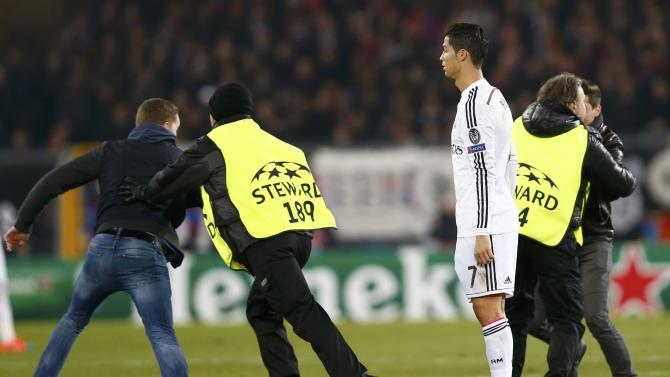 Real Madrid's Ronaldo watches as fans run on the field during their Champions League Group B soccer match against FC Basel
