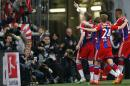Bayern's Bastian Schweinsteiger, left, celebrates after scoring his side's opening goal during the German first division Bundesliga soccer match between FC Bayern Munich and Hertha BSC at the Allianz Arena in Munich, Germany, on Saturday, April 25, 2015. (AP Photo/Matthias Schrader)