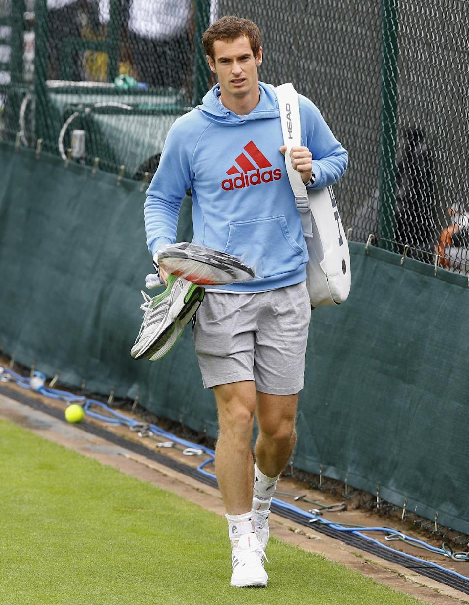 Andy Murray of Britain arrives for a training session at the Wimbledon tennis championships in London, Sunday, June 23, 2013. The Championships start Monday, with defending men's champion Roger Federer of Switzerland attempting to win the title for the eighth time. (AP Photo/Kirsty Wigglesworth)