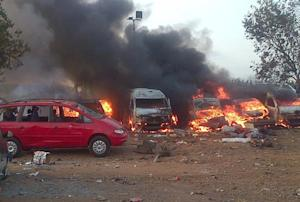 Vehicles burn after an attack in Abuja, Nigeria, on …