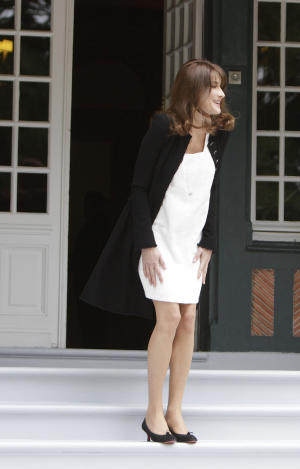 French President Nicolas Sarkozy's wife, Carla Bruni-Sarkozy, waits for arrivals at the Villa Strassburger during the G8 summit in Deauville, France, Thursday, May 26, 2011. Spouses of G8 leaders meet on the sidelines of the formal summit to discuss such issues as the fight against illiteracy. (AP Photo/Virginia Mayo, Pool)