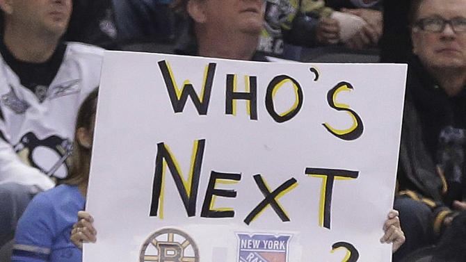 A young Pittsburgh Penguins fan holds a sign during a timeout in the second period in Game 5 of the Eastern Conference semifinals in their NHL hockey Stanley Cup playoffs series between the Pittsburgh Penguins and Ottawa Senators, Friday, May 24, 2013, in Pittsburgh. (AP Photo/Gene J. Puskar)