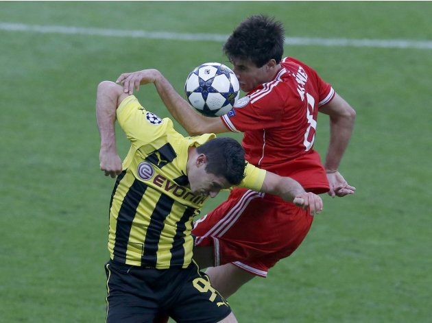 Bayern Munich's Javi Martinez challenges Borussia Dortmund's Robert Lewandowski during their Champions League Final soccer match at Wembley Stadium in London