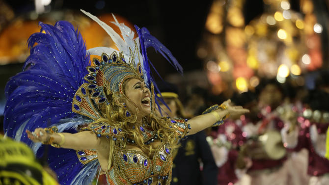Drum queen Bruna Almeida, from Sao Clemente samba school, dances during carnival parade at the Sambadrome in Rio de Janeiro, Brazil, Monday, Feb. 11, 2013. (AP Photo/Silvia Izquierdo)