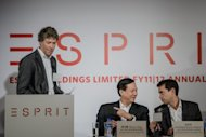 Esprit executive director and group CEO Thomas Tang (C), seen next to newly appointed Esprit chief executive Jose Manuel Martinez Gutierrez (R) as his predecessor Ronald van der Vis ends his speech during an annual results press conference in Hong Kong, on September 26. Esprit plans to raise up to $677 mln in a new share sale to rebuild its brand, according to a report