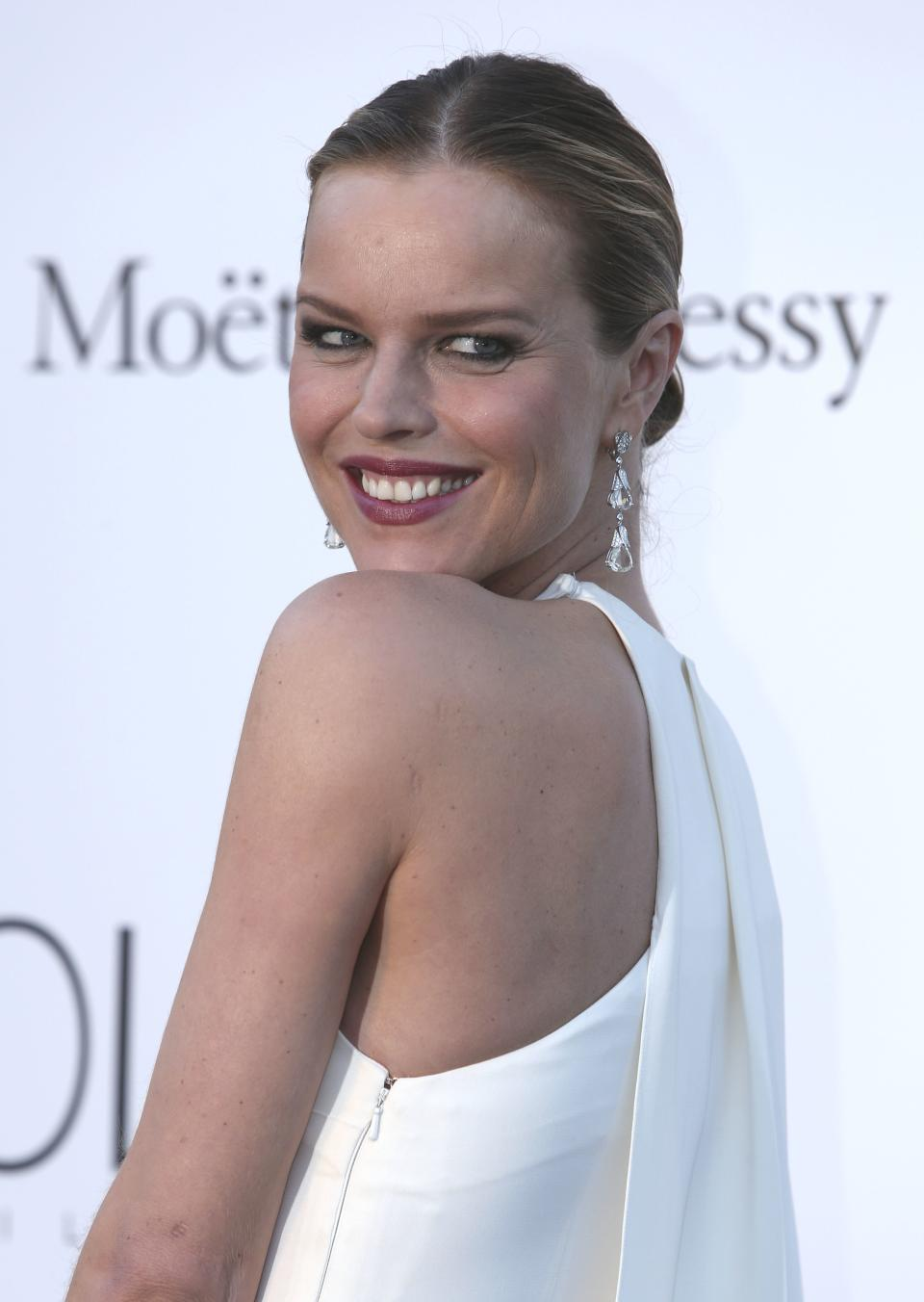 Model Eva Herzigova arrives at amfAR Cinema Against AIDS benefit at the Hotel du Cap-Eden-Roc, during the 66th international film festival, in Cap d'Antibes, southern France, Thursday, May 23, 2013. (Photo by Joel Ryan/Invision/AP)