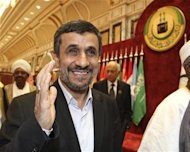 Iran's President Mahmoud Ahmadinejad arrives at the opening ceremony of the Organisation of Islamic Conference (OIC) summit in Mecca August 14, 2012. REUTERS/Susan Baaghil