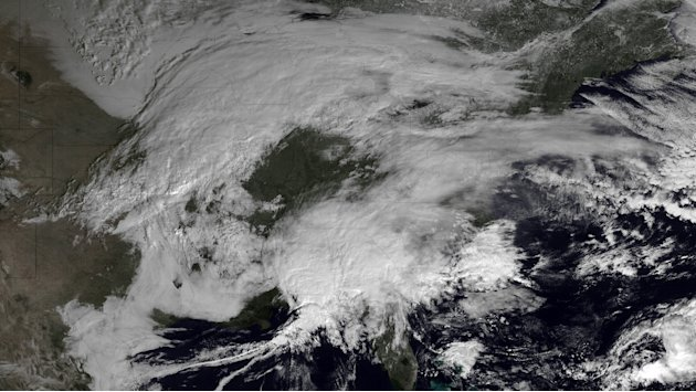 This image made available by NOAA shows storm systems over the eastern half of the United States on Thursday, Feb. 7, 2013 at 11:15 EST. A blizzard of potentially historic proportions threatened to st