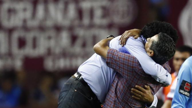 Astrada, head coach of Paraguay's Cerro Porteno, celebrates with assistant coach Diaz after their team defeated Argentina's Lanus in their Copa Sudamericana soccer match in Buenos Aires