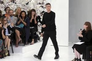 Belgian designer Raf Simons appears at the end of his Haute Couture Fall/Winter 2014-2015 fashion collection for French fashion house Christian Dior in Paris