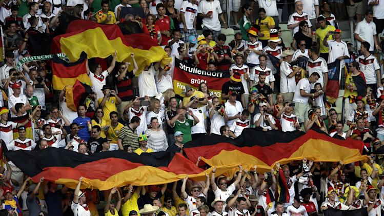 German soccer team fans cheer on their team on the tribune prior to the group G World Cup soccer match between Germany and Ghana at the Arena Castelao in Fortaleza, Brazil, Saturday, June 21, 2014. (AP Photo/Themba Hadebe)