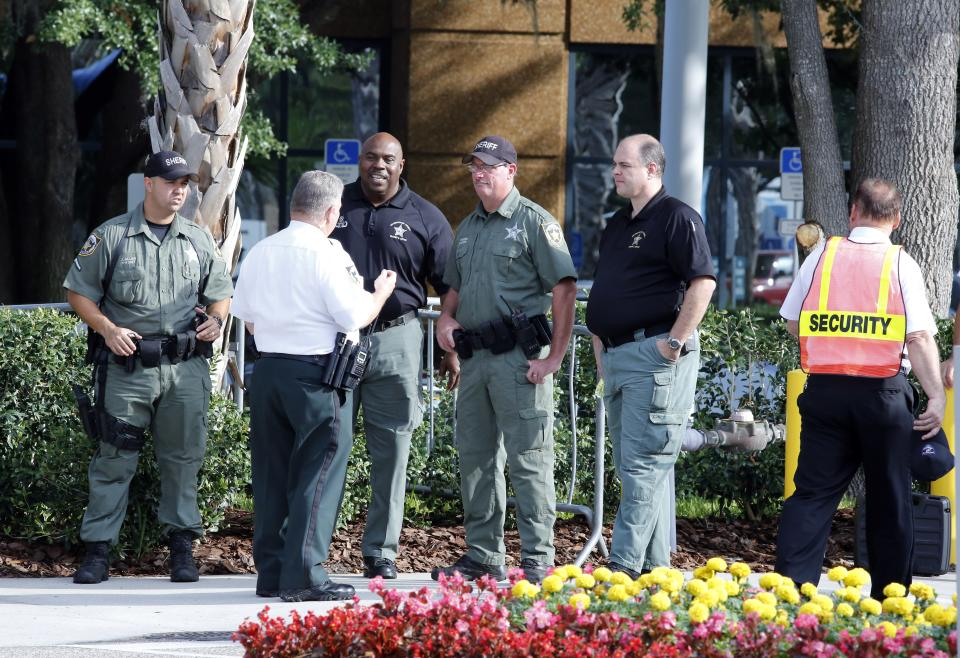 Hillsborough Sheriff deputies patrol outside the gate of JPMorgan Chase annual stockholders meeting held Tuesday, May 15, 2012, in Tampa, Fla. JPMorgan Chase CEO Jamie Dimon will speak to shareholders five days after disclosing a $2 billion trading loss. (AP Photo/Scott Iskowitz)