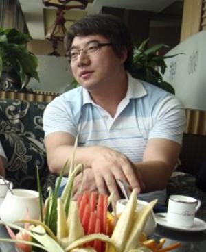 "In this undated photo released by his supporters, Zhai Xiaobing sits at a restaurant in Beijing. Hundreds of Chinese Internet users are rallying around the Beijing blogger who has been detained by police after posting a joke on Twitter about the pivotal Communist Party congress. Zhai's Nov. 5 tweet suggested the next movie in the ""Final Destination"" horror franchise would be about the Great Hall of the People collapsing on party delegates. A Miyun county police officer told The Associated Press on Wednesday, Nov. 21, 2012, that Zhai was being investigated for ""spreading terrorist information."" (AP Photo/Supporters of Zhai Xiaobing)"