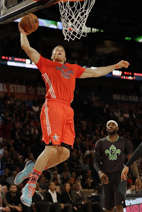 West Team's Blake Griffin, of the Los Angeles Clippers (32) heads to the hoop as East Team's LeBron James, of the Miami Heat (6) looks on during the NBA All Star basketball game, Sunday, Feb.