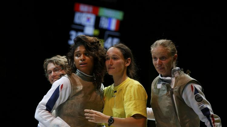 Members of France's women's foil team react during thier third place match against South Korea at the World Fencing Championships in Kazan