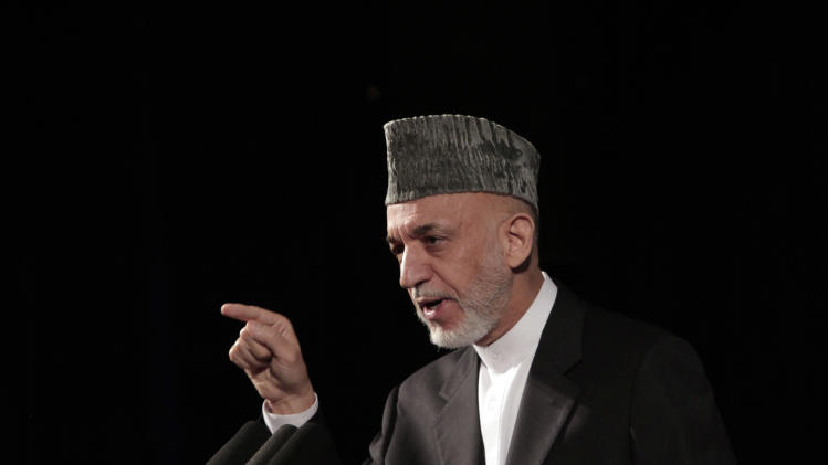 Afghan President Hamid Karzai speaks during a youth conference in Kabul, Afghanistan, Tuesday, Sept. 17, 2013. Afghanistan's president said Tuesday that he was in no rush to sign a security deal with the United States, once again dashing American hopes that a pact can be quickly finalized. (AP Photo/Rahmat Gul)
