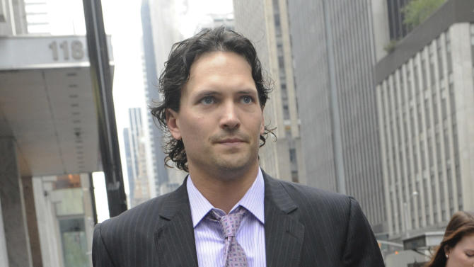 Winnipeg Jets' Ron Hainsey takes a break from a bargaining session at NHL headquarters in New York, Friday, Sept. 28, 2012. The NHL and the players' association agreed on issues related to player safety and drug testing Friday, but the core economic divide that is preventing an end to the league's latest lockout was not even on the agenda. (AP Photo/Louis Lanzano)