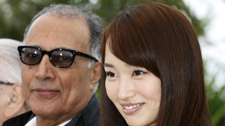 Director Abbas Kiarostami, left and actress Rin Takanashi pose during a photo call for Like Somone in Love at the 65th international film festival, in Cannes, southern France, Monday, May 21, 2012. (AP Photo/Lionel Cironneau)