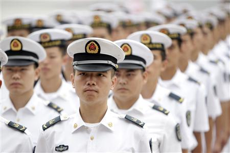 Chinese People's Liberation Army (PLA) navy sailors stand in a line and wait to attend a ceremony at the Great Hall of the People in Beijing, July 19, 2012. REUTERS/Jason Lee