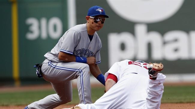 Boston Red Sox's Brandon Snyder, right, is safe with a two-run double as Toronto Blue Jays' Munenori Kawasaki, left, puts on the late tag in the second inning of a baseball game in Boston, Sunday, June 30, 2013. (AP Photo/Michael Dwyer)