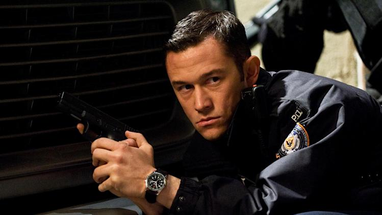 "In this publicity photo provided by Warner Bros. Pictures, Joseph Gordon-Levitt, as John Blake, is shown in a scene in Warner Bros. Pictures' and Legendary Pictures' action thriller ""The Dark Knight Rises,""  a Warner Bros. Pictures release. TM & © DC Comics. (AP Photo/Warner Bros. Pictures, Ron Phillips)"