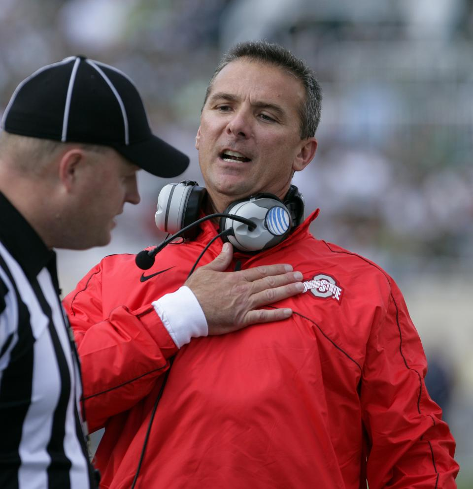 Ohio State coach Urban Meyer, right, argues a call during the first quarter of an NCAA college football game against Michigan State, Saturday, Sept. 29, 2012, in East Lansing, Mich. (AP Photo/Al Goldis)