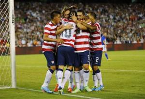 U.S. forward Landon Donovan is mobbed by teammates after scoring against Guatemala on a penalty kick in the second half during their friendly soccer match in San Diego