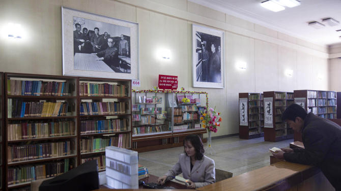 In this March 9, 2011 photo, a woman works on a library computer at the Grand People's Study House in Pyongyang, North Korea. North Korea is undergoing a digital revolution of sorts, even as it holds some of the strictest cyberspace policies in the world. (AP Photo/David Guttenfelder)