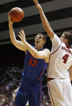 Florida forward Erik Murphy (33) drives to the basket against Alabama center Carl Engstrom (4) in the first half of an NCAA college basketball game in Tuscaloosa, Ala.,Tuesday, Feb. 14, 2012. (AP Photo/Robert Sutton)