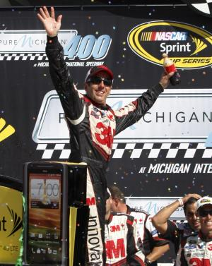 Greg Biffle celebates his victory in the NASCAR Sprint Cup Pure Michigan 400 auto race at Michigan International Speedway Sunday, Aug. 19, 2012, in Brooklyn, Mich. (AP Photo/Bob Brodbeck)
