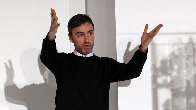 FILE -  This Sept. 25, 2011 file photo shows Belgian designer Raf Simons at the end of the Jil Sander Spring/Summer 2012 women's collection in Milan. Simons is the Creative Director at Christian Dior. (AP Photo/Giuseppe Aresu, file)