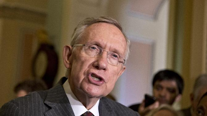 FILE - In this April 9, 2013, file photo, Senate Majority Leader Harry Reid, D-Nev., speaks with reporters about gun control at the Capitol in Washington. To hear party operatives describe the fight for the Senate, it's the boogeyman billionaires against the shifty septuagenarian. Reid has been relentless in his criticism against the wealthy industrialists Charles and David Koch (kohk), who fund a network of conservative groups. Now, Republicans are adjusting their plans and going after the 74-year-old Democratic Senate leader. (AP Photo/J. Scott Applewhite, File)