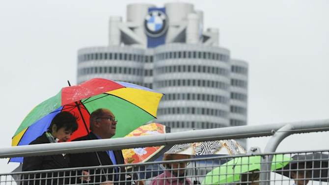 Shareholders arrive for the German luxury carmaker BMW annual shareholders meeting at the company's headquarters in Munich