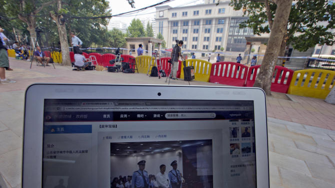 A website blog run by the Jinan Intermediate People's Court shows a picture of Bo Xilai attending the trial, near barricades outside the court in Jinan, in eastern China's Shandong province on Thursday Aug. 22, 2013. Disgraced populist politician Bo Xilai went on trial Thursday accused of abuse of power and netting more than $4 million in bribery and embezzlement, marking the ruling Communist Party's attempts to put to rest one of China's most lurid political scandals in decades. (AP Photo/Ng Han Guan)